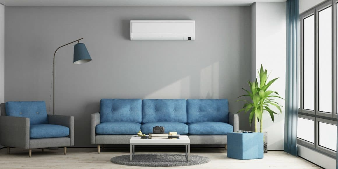 A modern apartment living room with an inverter air conditioner